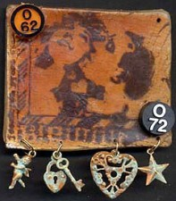 Stamped polymer clay pin with aged charms