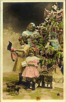 Vintage postcard, children around the Christmas tree, sent in by Susan Frank